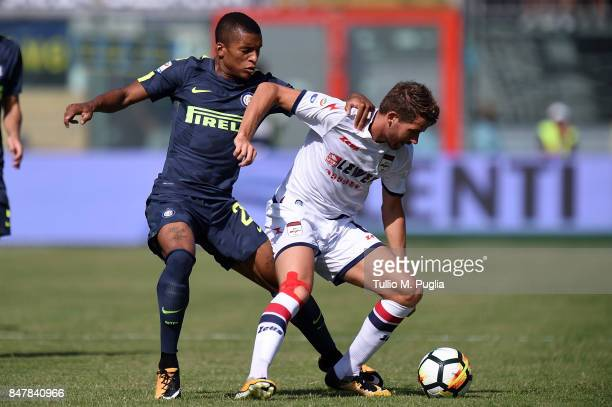 Henrique Dalbert of Internazionale and Marcus Christen Rohden of Crotone compete for the ball during the Serie A match between FC Crotone and FC...