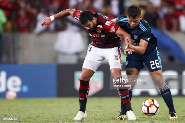 Henrique Dourado of Flamengo struggles for the ball with a Mejía of Emelec during a Group Stage match between Flamengo and Emelec as part of Copa...