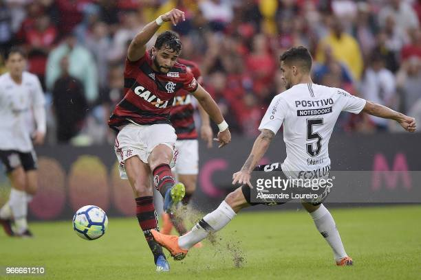 Henrique Dourado of Flamengo struggles for the ball with Gabriel of Corinthians during the match between Flamengo and Corinthians as part of...