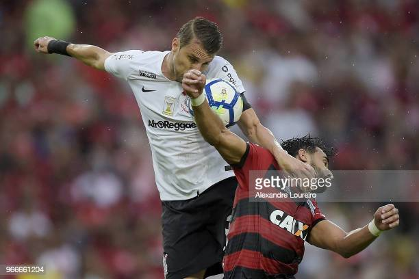 Henrique Dourado of Flamengo struggles for the ball with Henrique of Corinthians during the match between Flamengo and Corinthians as part of...