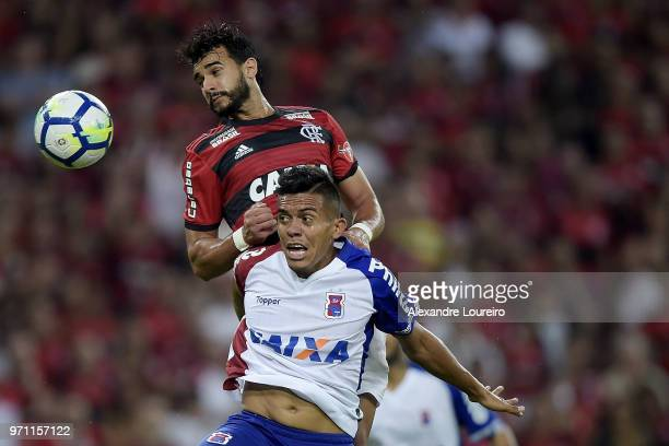 Henrique Dourado of Flamengo struggles for the ball with Júnior of Parana Clube during the match between Flamengo and Parana Clube as part of...