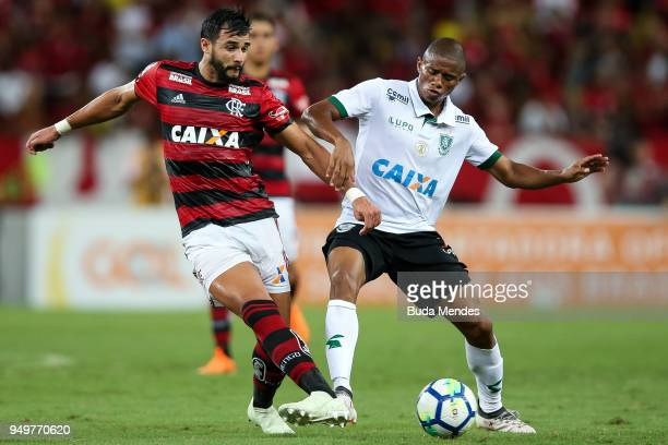 Henrique Dourado of Flamengo struggles for the ball with Juninho of America MG during a match between Flamengo and America MG as part of Brasileirao...