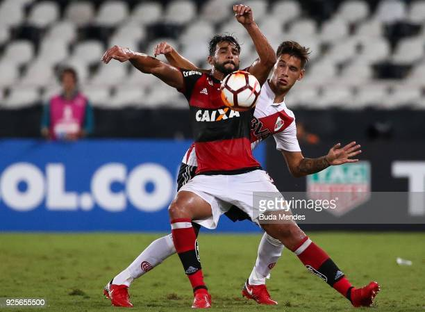 Henrique Dourado of Flamengo struggles for the ball with Marcelo Saracchi of River Plate during a match between Flamengo and River Plate as part of...