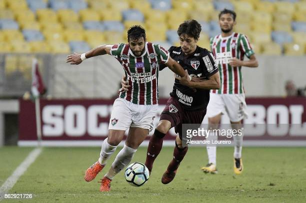 Henrique Dourado of Fluminense battles for the ball with Rodrigo Caio of Sao Paulo during the match between Fluminense and Sao Paulo as part of...