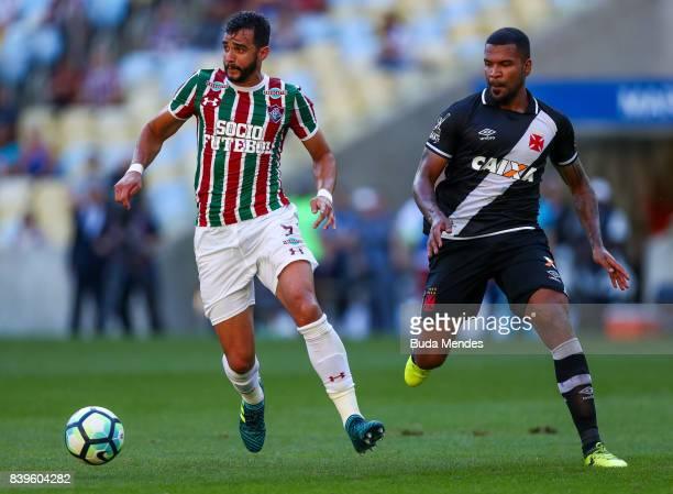 Henrique Dourado of Fluminense struggles for the ball with and Breno of Vasco da Gama during a match between Fluminense and Vasco da Gama as part of...