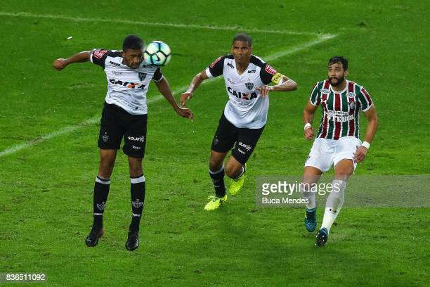 Henrique Dourado of Fluminense struggles for the ball with Bremer and Leonardo Silva of Atletico MG during a match between Fluminense and Atletico MG...