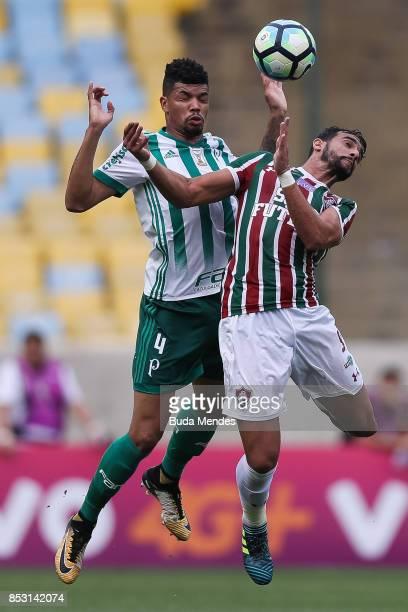 Henrique Dourado of Fluminense struggles for the ball with Juninho of Palmeiras during a match between Fluminense and Palmeiras as part of...