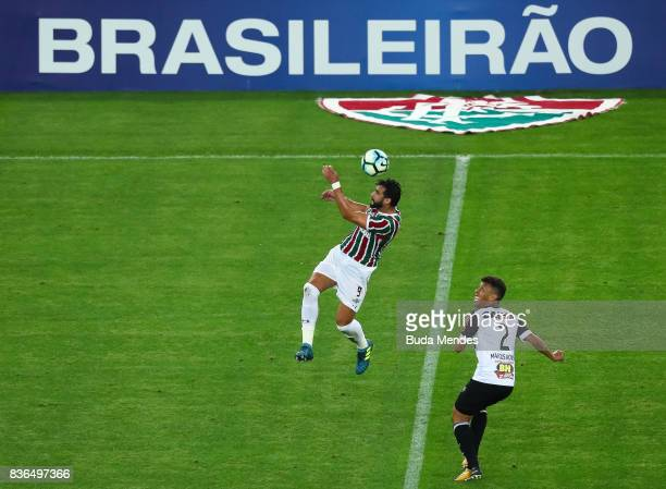 Henrique Dourado of Fluminense struggles for the ball with Marcos Rocha of Atletico MG during a match between Fluminense and Atletico MG part of...