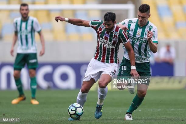 Henrique Dourado of Fluminense struggles for the ball with Moises of Palmeiras during a match between Fluminense and Palmeiras as part of Brasileirao...