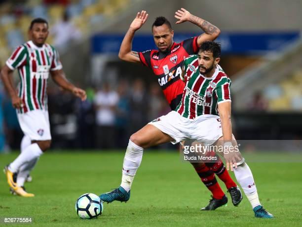 Henrique Dourado of Fluminense struggles for the ball with Niltinho of Atletico GO during a match between Fluminense and Atletico GO as part of...