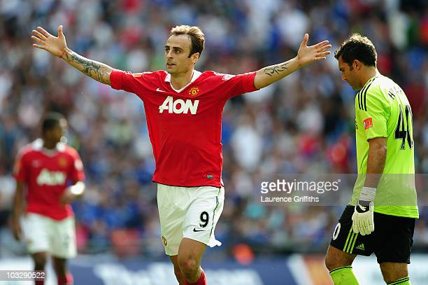 Henrique Hilario of Chelsea looks dejected as Dimitar Berbatov of Manchester United celebrates as he scores their third goal during the FA Community...