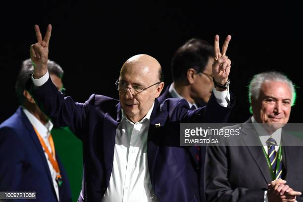 Henrique Meirelles flashes the Vsign next to Brazilian President Michel Temer during the launching of Meirelles' candidacy for the presidency of...