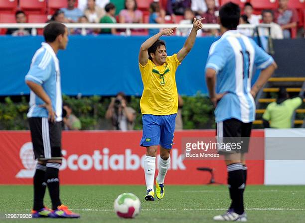 Henrique Nascente of Brazil celebrates a scored goal againist Argentina during a match as part of XVI Pan American Games at Ominilife stadium on...