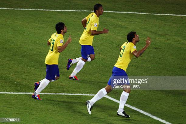 Henrique of Brazil celebrates his team's first goal with team mates during the FIFA U20 World Cup 2011 round of 16 match between Brazil and Saudi...