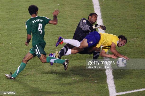 Henrique of Brazil is challenged by goalkeeper Abdullah Alsdairy and Mohammed Alfatil of Saudi Arabia during the FIFA U20 World Cup 2011 round of 16...