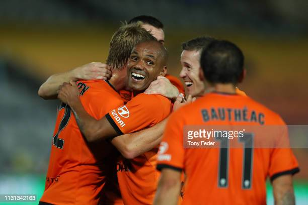 Henrique of Brisbane Roar celebrate a goal with team mates during the Round 20 ALeague Match between the Central Coast Mariners and Brisbane Roar FC...