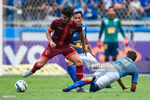Henrique of Cruzeiro and Alexandre Pato of Sao Paulo battle for the ball during a match between Cruzeiro and Sao Paulo as part of Brasileirao Series...