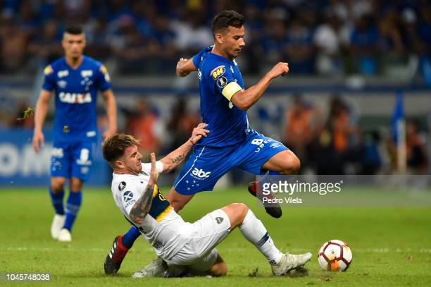 Henrique of Cruzeiro struggles for the ball with Buffarini of Boca Juniors during a match between Cruzeiro and Boca Juniors as part of Copa CONMEBOL...