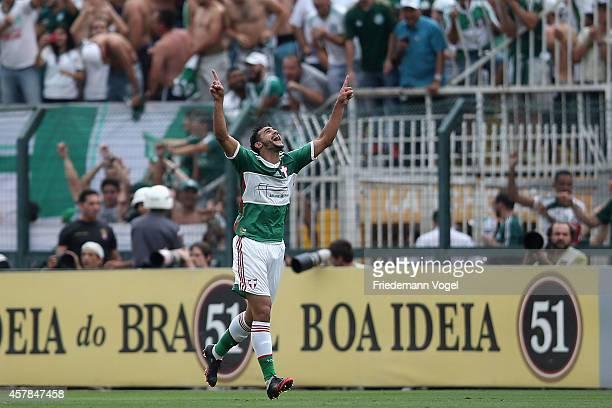 Henrique of Palmeiras celebrates scoring the first goal during the match between Palmeiras and Corinthians for the Brazilian Series A 2014 at Estadio...