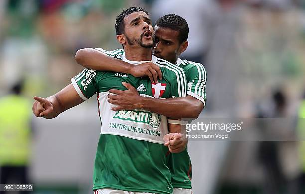 Henrique of Palmeiras celebrates scoring the first goal with Mazinho during the match between Palmeiras and Atletico PR for the Brazilian Series A...