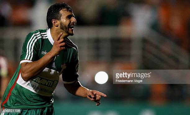 Henrique of Palmeiras celebrates scoring the fourth goal during the match between Palmeiras and Chapecoense for the Brazilian Series A 2014 at...