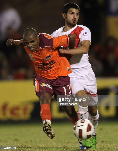 Henrique of the Roar and Aziz Behich of the Heart compete for the ball during a preseason ALeague match between Brisbane Roar and Melbourne Heart at...