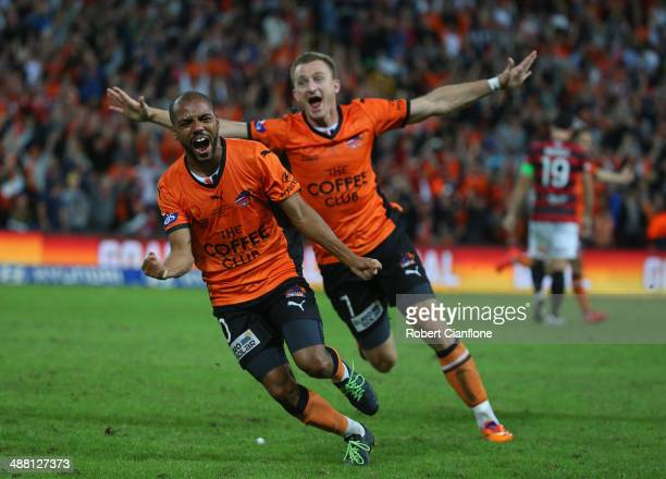 Henrique of the Roar celebrates after he scored in extra time during the 2014 ALeague Grand Final match between the Brisbane Roar and the Western...