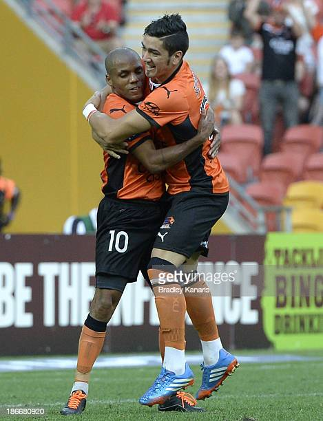 Henrique of the Roar celebrates with Dimitri Petratos after scoring a goal during the round four ALeague match between Brisbane Roar and the...