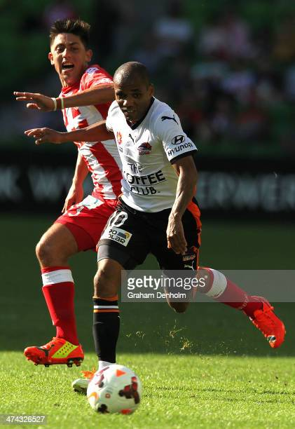 Henrique of the Roar dribbles with the ball under pressure from Jonatan Germano of the Heart during the round 20 ALeague match between Melbourne...