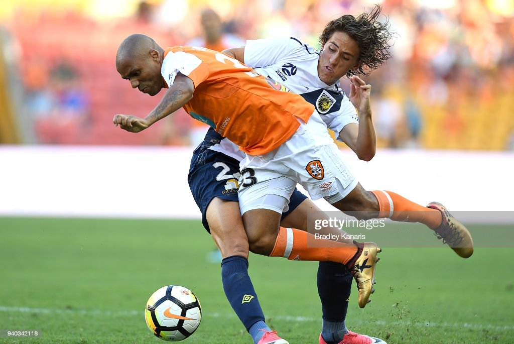 Henrique of the Roar is tackled by Lachlan Wales of the Mariners during the round 25 A-League match between the Brisbane Roar and the Central Coast Mariners at Suncorp Stadium on March 31, 2018 in Brisbane, Australia.