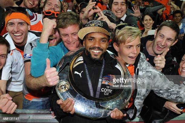 Henrique of the Roar poses for a photograph with fans after winning the 2014 ALeague Grand Final match between the Brisbane Roar and the Western...