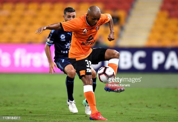 Henrique of the Roar takes on the defence during the round 18 A-League match between the Brisbane Roar and Sydney FC at Suncorp Stadium on February...