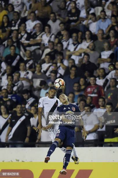 Henrique of Vasco da Gama struggles for the ball with Matías Rodriguez of Universidad de Chile during a Group Stage match between Vasco and...