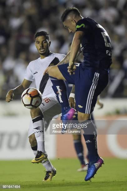 Henrique of Vasco da Gama struggles for the ball with Rodrigo Echeverría of Universidad de Chile during a Group Stage match between Vasco and...