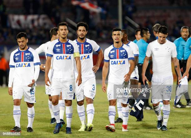 Henrique Pacheco Egidio of Cruzeiro and teammates leave the field after the equalizer between U of Chile and Cruzeiro as part of Copa CONMEBOL...