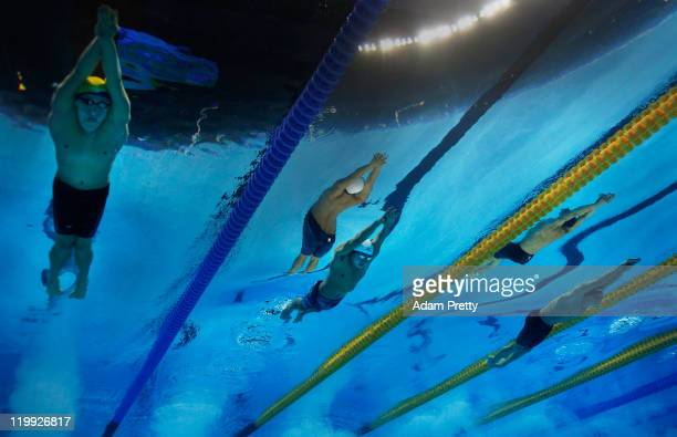 Henrique Rodrigues of Brazil Yuya Horihata of Japan and David Verraszto of Hungary compete in the first semifinal heat of the Men's 200m Individual...