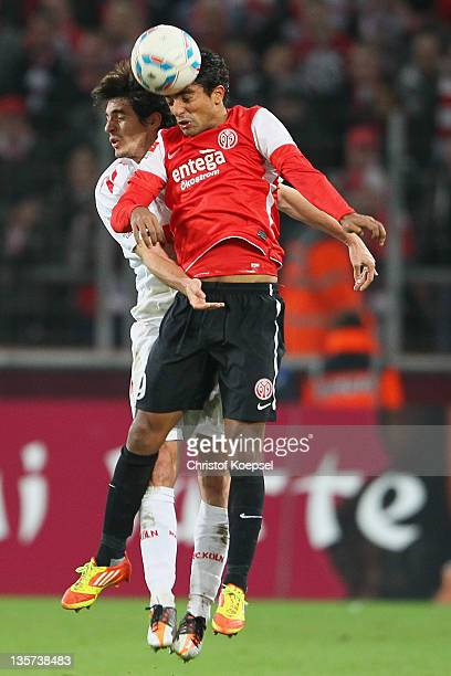 Henrique Sereno of Koeln and Sami Allagui of Mainz go up for a header during the Bundesliga match between 1 FC Koeln and FSV Mainz 05 at...
