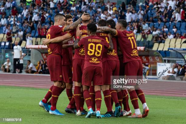 Henrix Mkhitaryan of As Roma celebrates with his team after scoring a goal during the Serie A match between AS Roma and Sassuolo at Olimpico Stadium