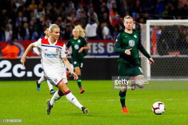 Henry Amandine of Lyon and Alexandra Popp of Wolfsburg during the Women's Champions League match between Lyon and Wolfsburg on March 20 2019 in Lyon...