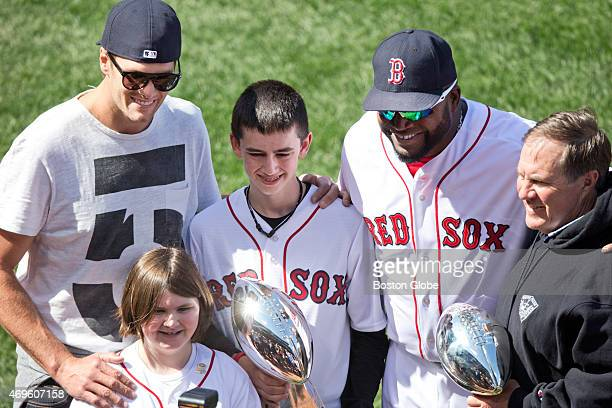 Henry and Jane Richard the older brother and younger sister of Boston Marathon bombing victim Martin Richard are surrounded by Red Sox designated...