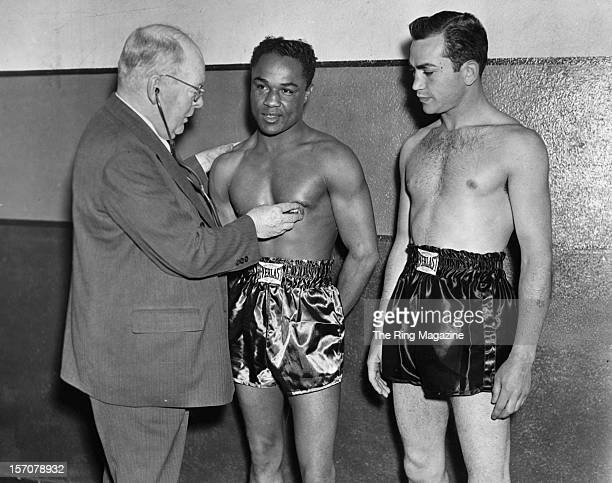 Henry Armstrong and Barney Ross have a pre bout examination before their fight at Madison Square Garden Bowl on May 311938 in Long Island City Queens...