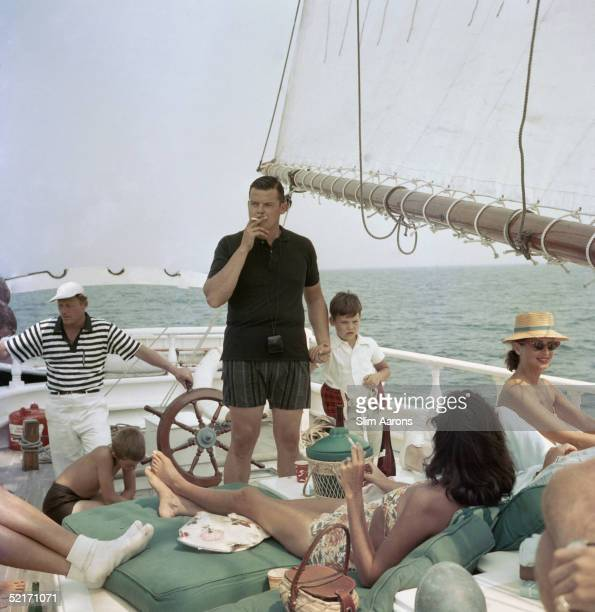 Henry B Cabot Jr with his son Henry Bromfield Cabot III and their host Barclay H Warburton III aboard the brigantine 'Black Pearl' circa 1959 They...