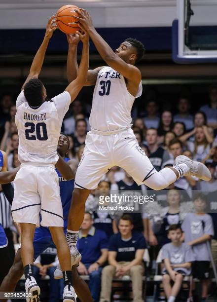 Henry Baddley and Kelan Martin of the Butler Bulldogs reach for the ball during the game against the Creighton Bluejays at Hinkle Fieldhouse on...