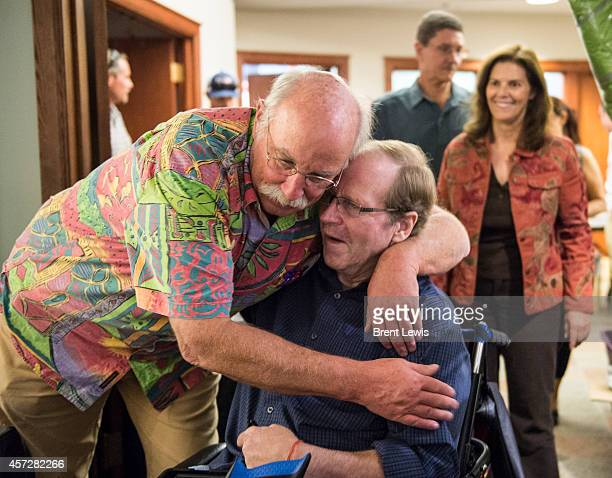 Henry Barber hugs Jeff Lowe during the Ouroy Ice Park Road Show event Wednesday October 15 2014 at the American Mountaineering Center in Golden...