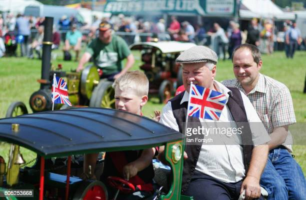 Henry Barnfather from Swainby drives his miniature steam engine as his grandfather and father sit behind him during the Duncombe Park Steam Rally on...
