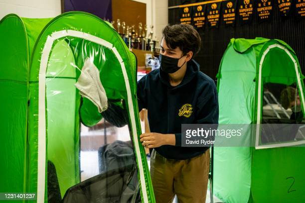 Henry Bergey cleans his pop-up tent during wind ensemble class at Wenatchee High School on February 26, 2021 in Wenatchee, Washington. The school has...