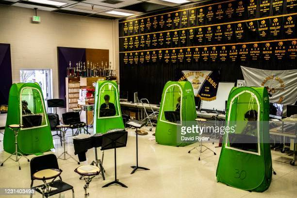 Henry Bergey, Lars Sorom, Clay Lancaster, and Storm Hedman sit in pop-up tents during wind ensemble class at Wenatchee High School on February 26,...