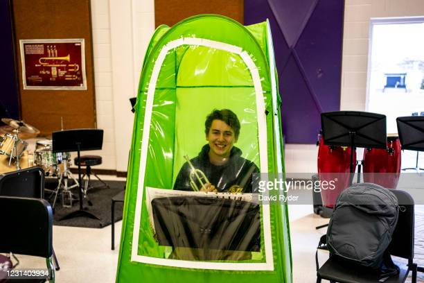 Henry Bergey poses for a portrait with a trumpet in his pop-up tent during wind ensemble class at Wenatchee High School on February 26, 2021 in...
