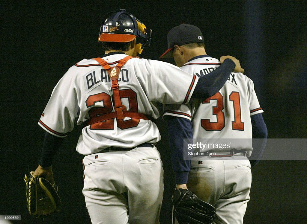 Henry Blanco #20 catcher of the Atlanta Braves talks with pitcher Greg Maddux #31 in their game the Los Angeles DodgersMay 14, 2003 at Dodger Stadium in Los Angeles, California. Maddux picked up his fifth loss of the season as the Dodgers won 5-1.