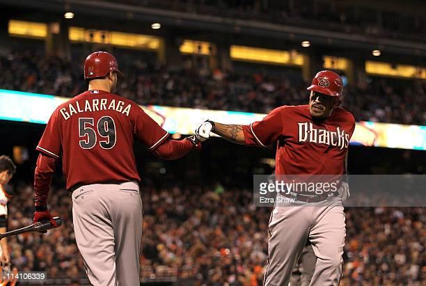 Henry Blanco of the Arizona Diamondbacks is congratulated by Armando Galarraga after Blanco hit a home run against the San Francisco Giants at ATT...